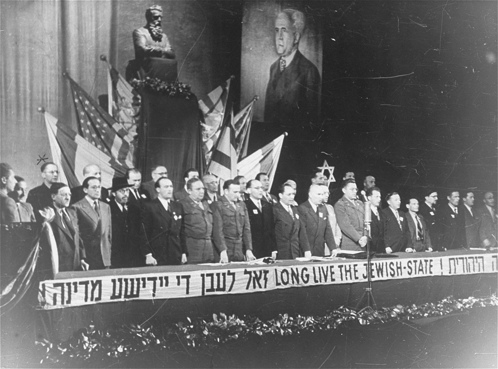 A meeting of the Central Committee of Liberated Jews in the US Zone of Germany celebrating the establishment of the State of Israel.