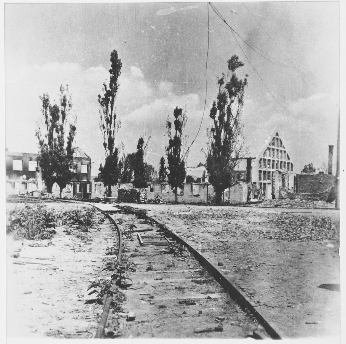 View of train tracks leading to the gate of the destroyed Jasenovac concentration camp.