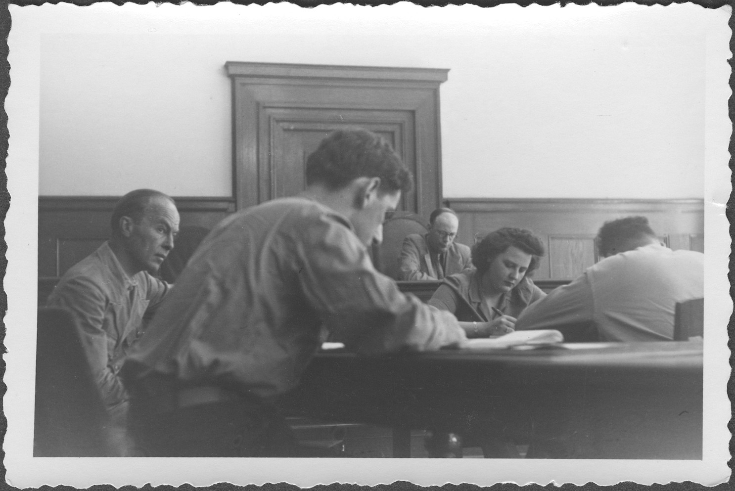 Interrogation of General Roettiger before Commissioner Rasumov at the IMT Nuremberg commission hearings investigating indicted Nazi organizations.