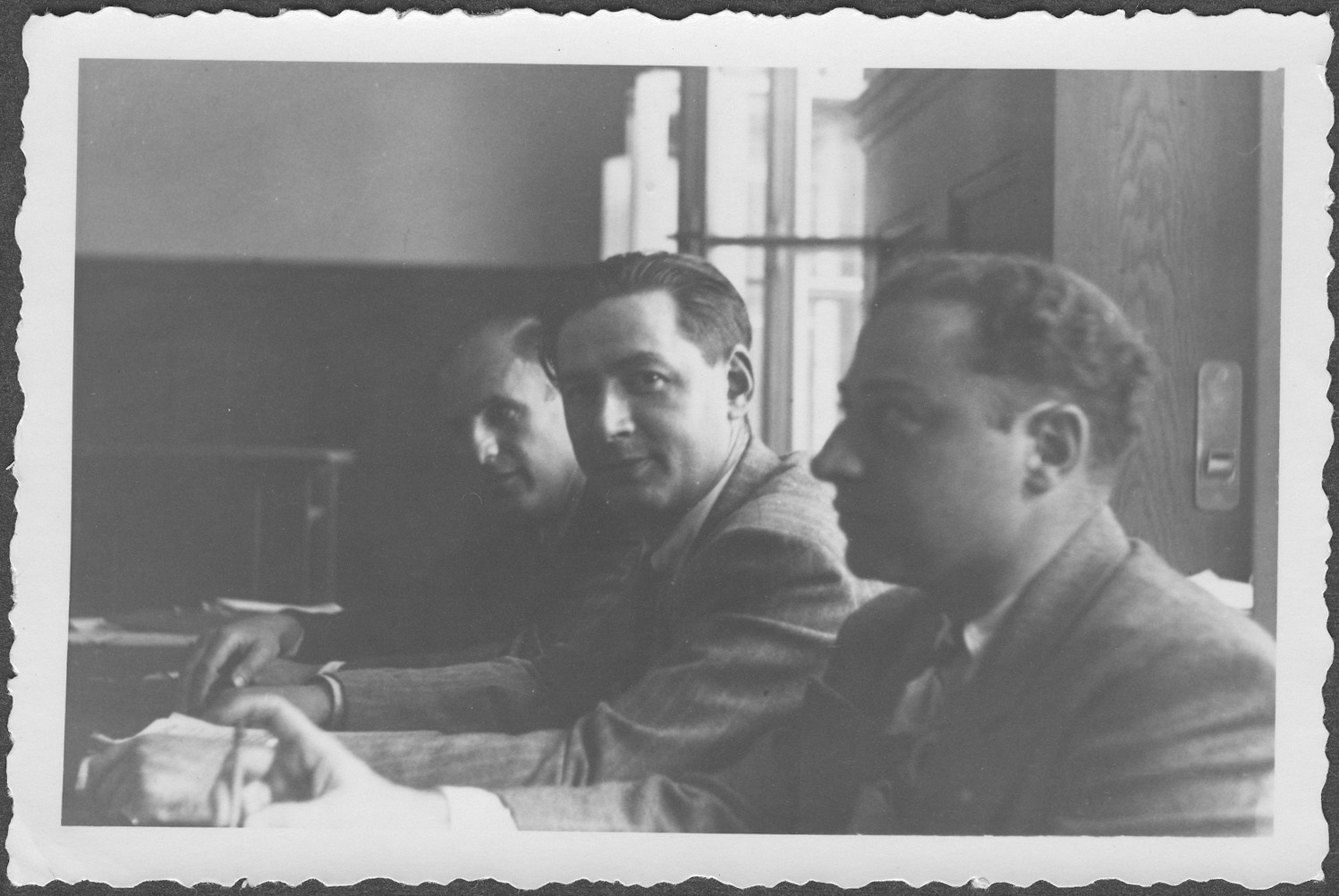 Close-up of three American prosecutors at the IMT Nuremberg commission hearings investigating indicted Nazi organizations.   Pictured from right to left are: Mr. Niederman, Mr. Rapp, and Robert M.W. Kempner.