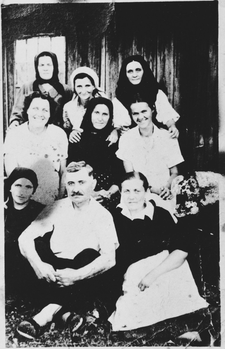 Group portrait of the staff of children's kitchen in the Sisak internment camp.  Among those pictured are Staka Visnjic (back row, center) and Milica Vzelac (center row, right).