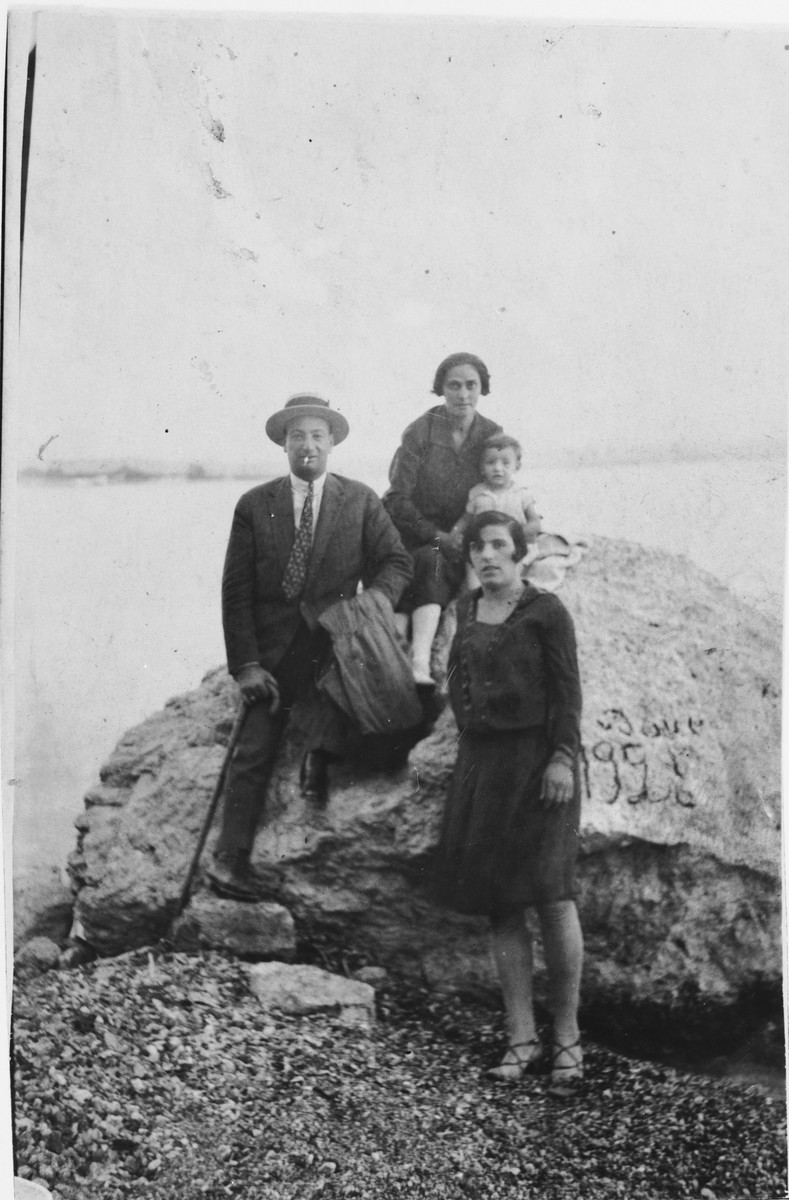 The Nehama family poses at a spa at Loutraki, a town 100 miles west of Athens.  Pictured clockwise from top are a Greek nanny, Isaac Nehama, Sarah (Kolonomos) Nehama, and Dario Nehama.