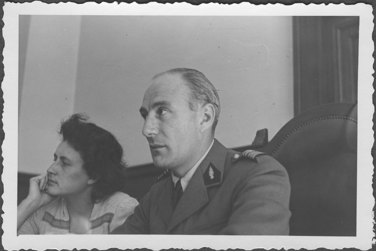 French Commissioner Colonel A. Martin-Havard listens to testimony at the IMT Nuremberg commission hearings investigating indicted Nazi organizations.    Seated at the left is the commissioner's interpreter.