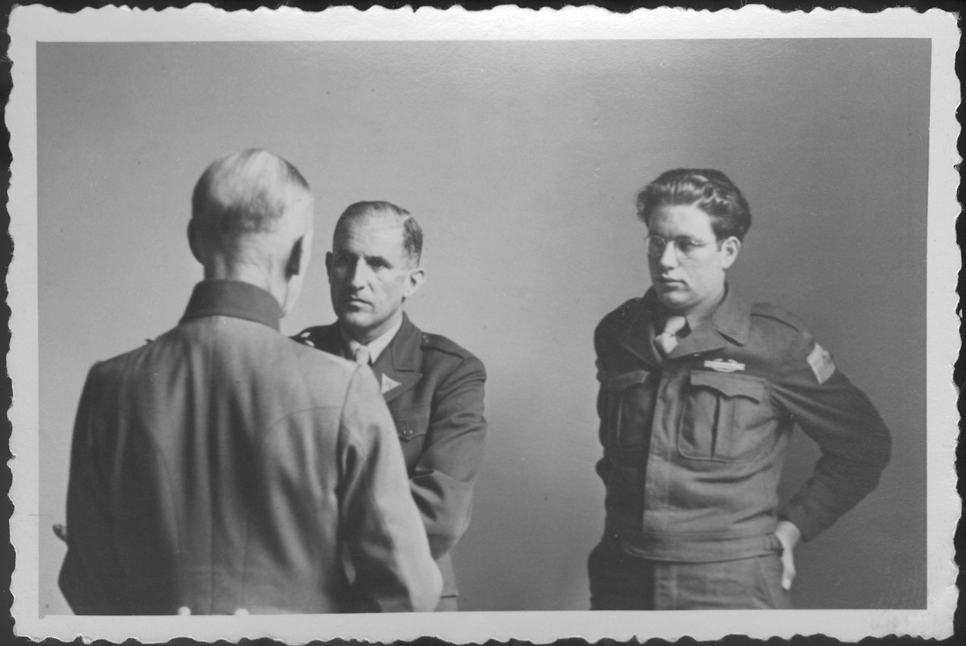German Field Marshall Gerd von Rundstedt (with his back to the camera) speaks to American prosecutor Robert Kempner (left) and interpreter Gerald Schwab during a pause at the IMT Nuremberg commission hearings investigating the Supreme Command of the German Armed Forces, OKW.