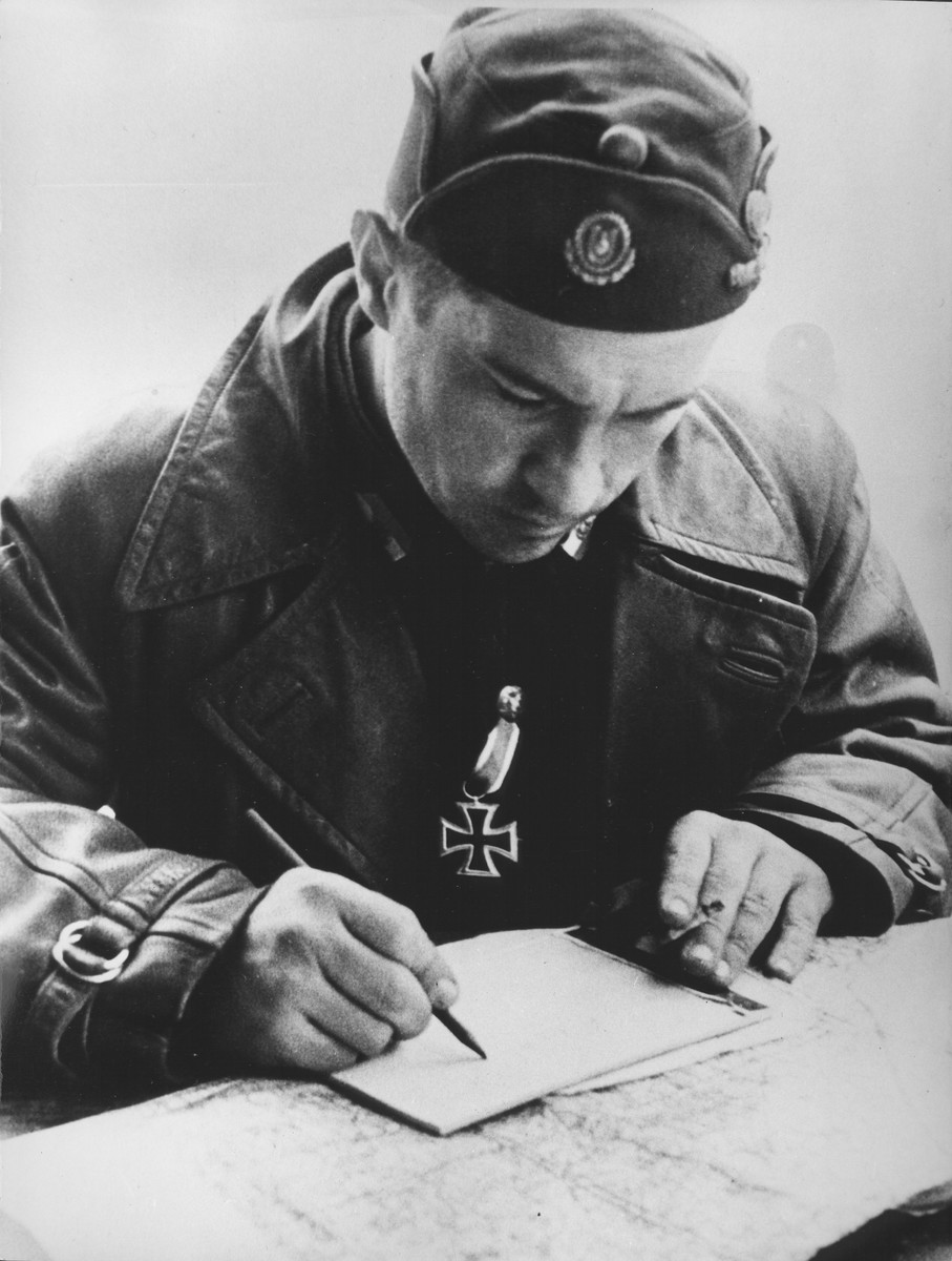Ustasa Colonel Vjekoslav (Maks) Luburic signs a document.