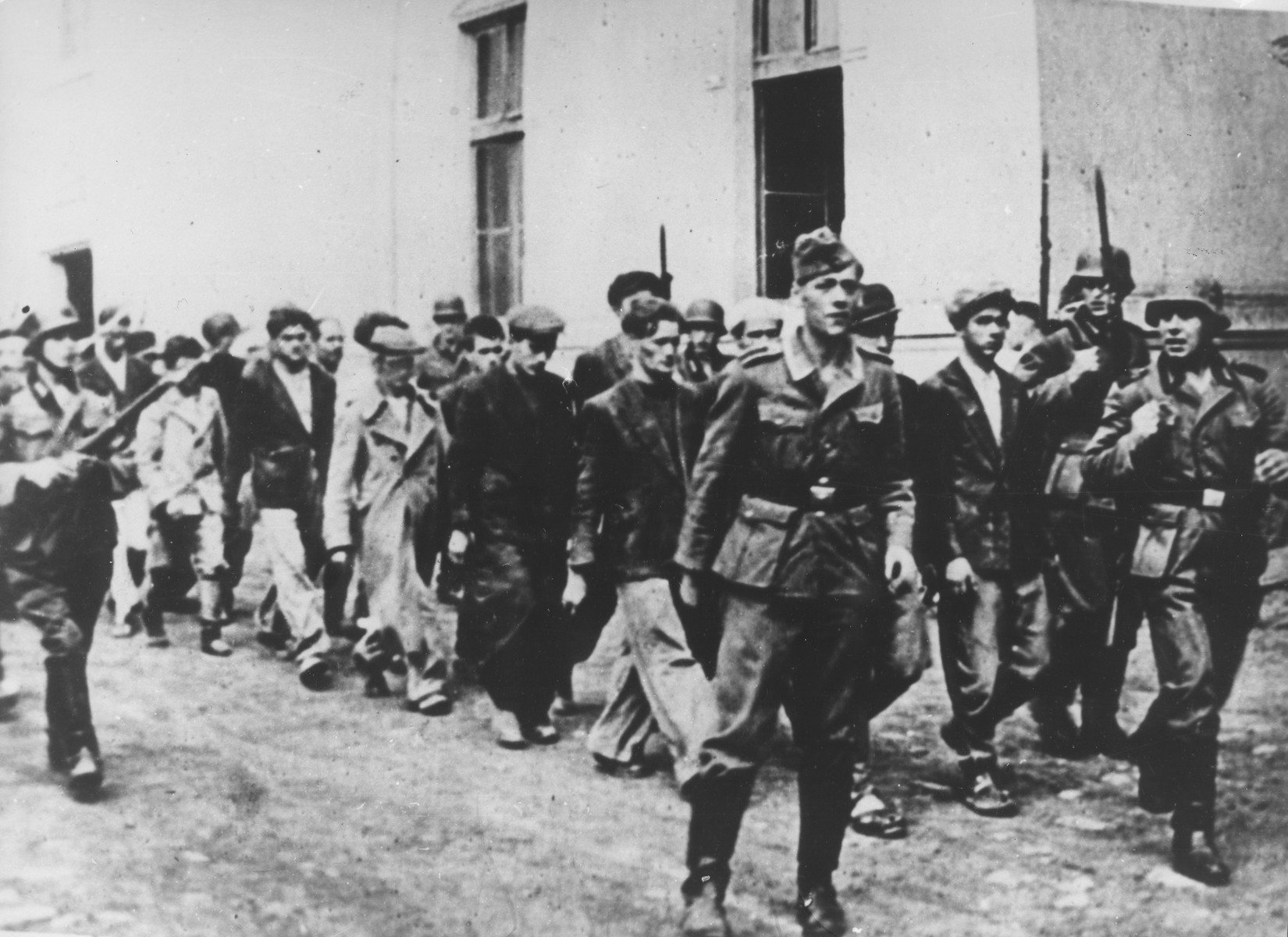 Germans escort people from Kragvjevac and its surrounding area to be executed.