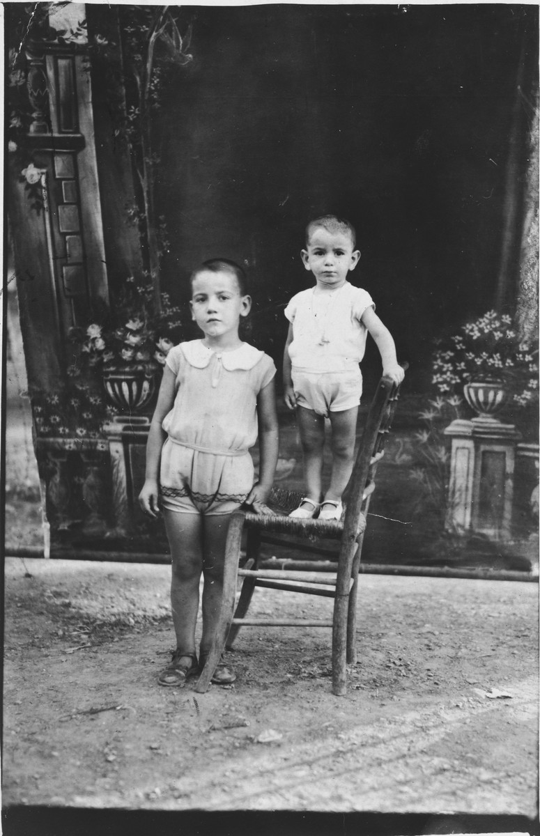 Studio portrait of two Jewish brothers from Athens.  Pictured are Isaac (left) and Samuel (right) Nehama.