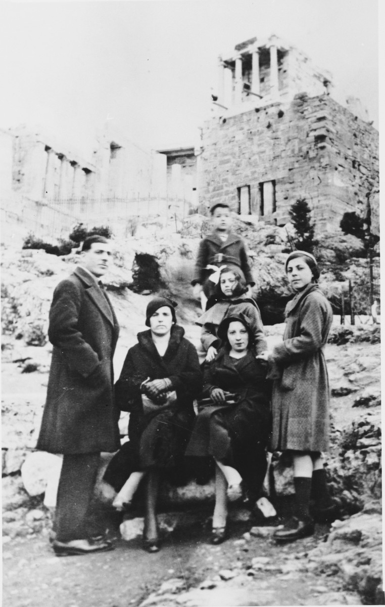 A family of Greek Jews poses at the Parthenon in Athens.  Pictured in front from left to right are Isaac Cases, Sarah (Kolonomos) Nehama, Donna Kolonomos Cases and Rachel Cases.  Standing behind in the center is Miriam Cases.  Standing at the top is Isaac Nehama.