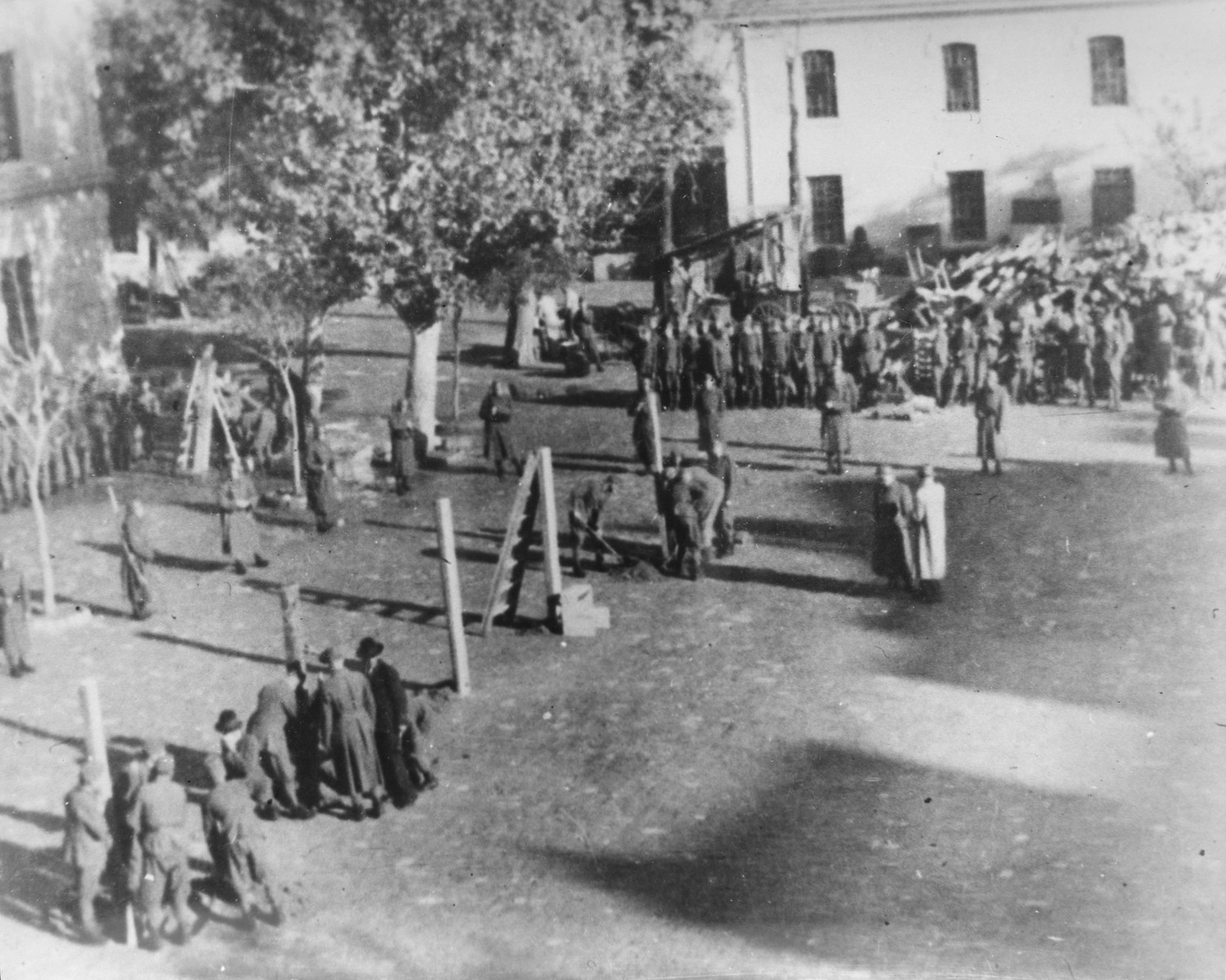 "Hungarian occupation troops prepare the gallows for the public execution of members of the ""NOP"" in Novi Sad."