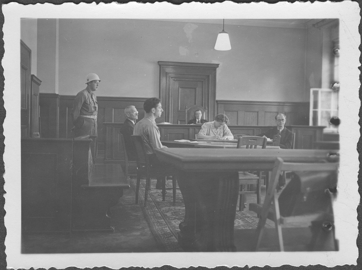 Interrogation of General Franz Halder, former Chief of Staff of the German Armed Forces at the IMT Nuremberg commission hearings investigating indicted Nazi organizations.  Commissioner McIlwraith is pictured in the background.