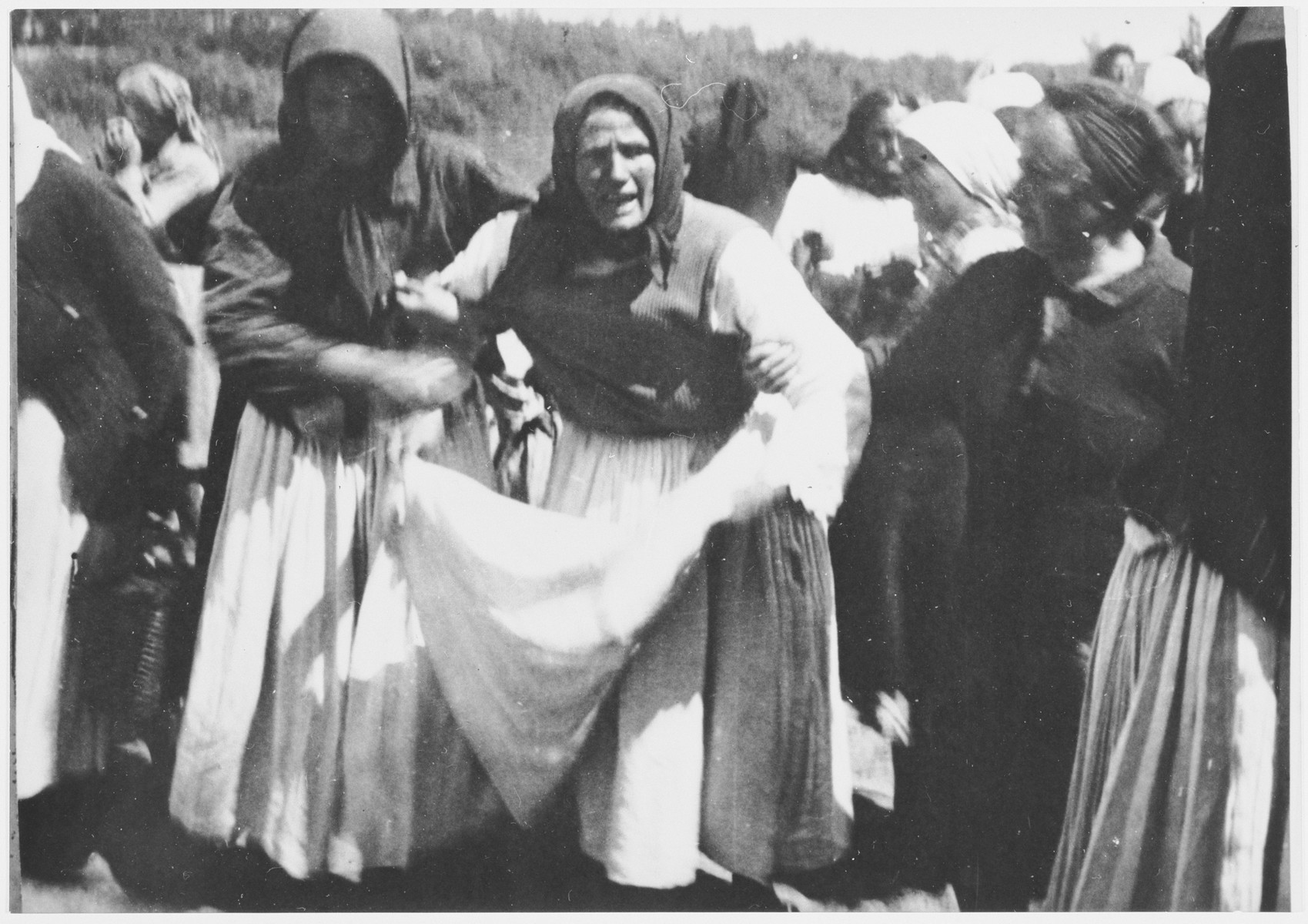 Grief stricken family members of prisoners killed at the Sisak concentration camp, gather along the banks of the Sava River where many bodies of camp victims were found.