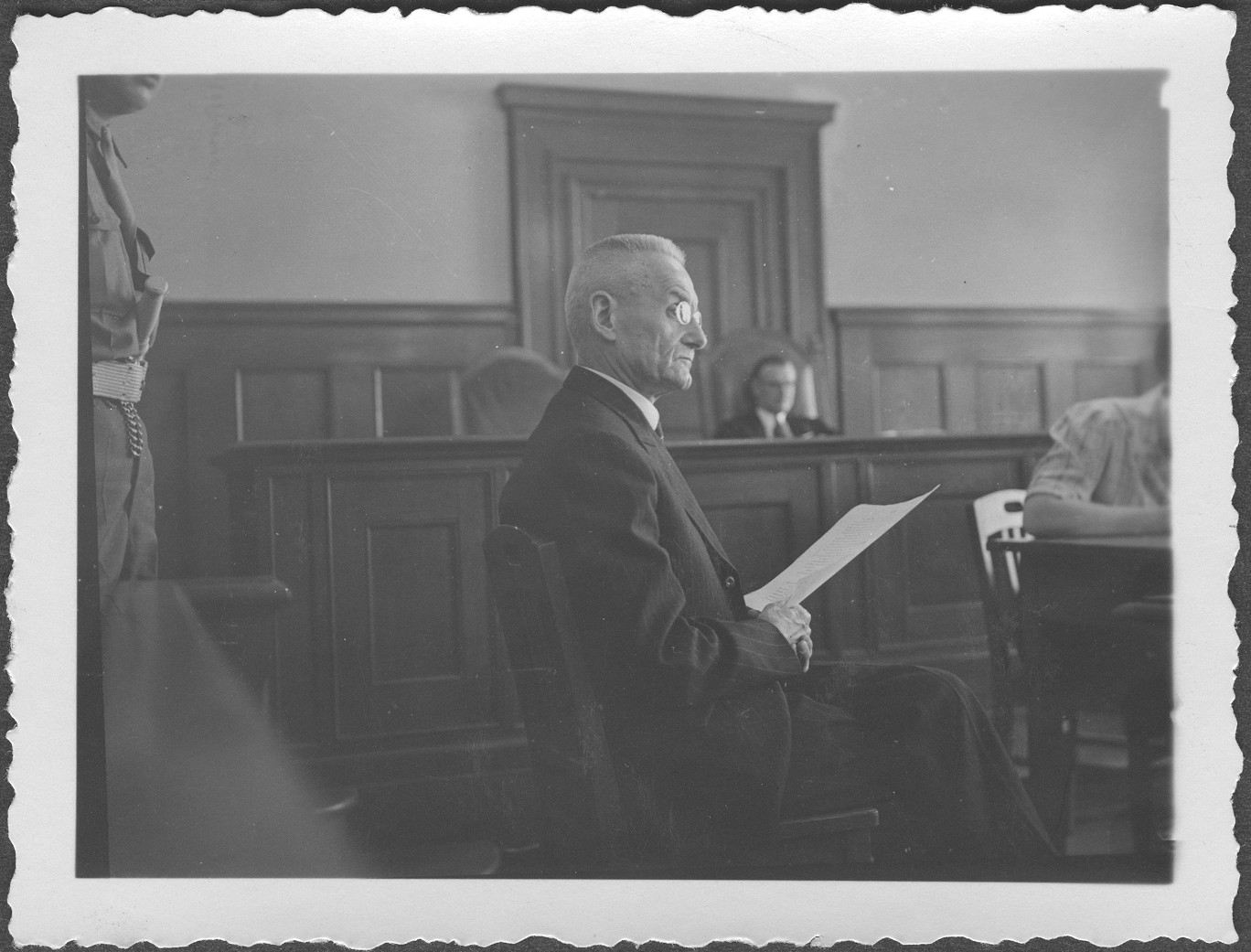 General Franz Halder, former Chief of Staff of the German Armed Forces, testifies before Commissioner Ian D. McIlwraith at the IMT Nuremberg commission hearings investigating indicted Nazi organizations.