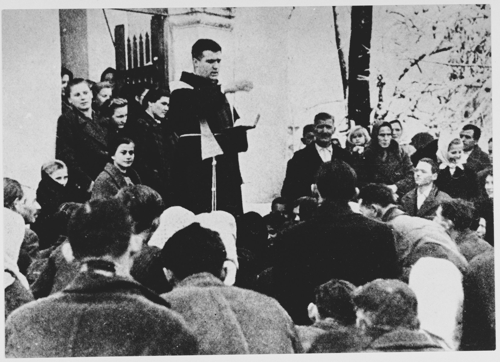 Serbian civilians are forcibly converted to Catholicism by a Croatian priest.