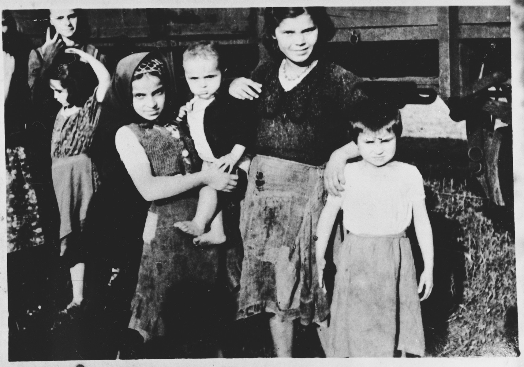 Group portrait of women and children in the Pecana camp in Sisak (near the village of Goldovo).  Most of the children are from the Serbian village of Gornje Dubrave in the district of Ogulin.