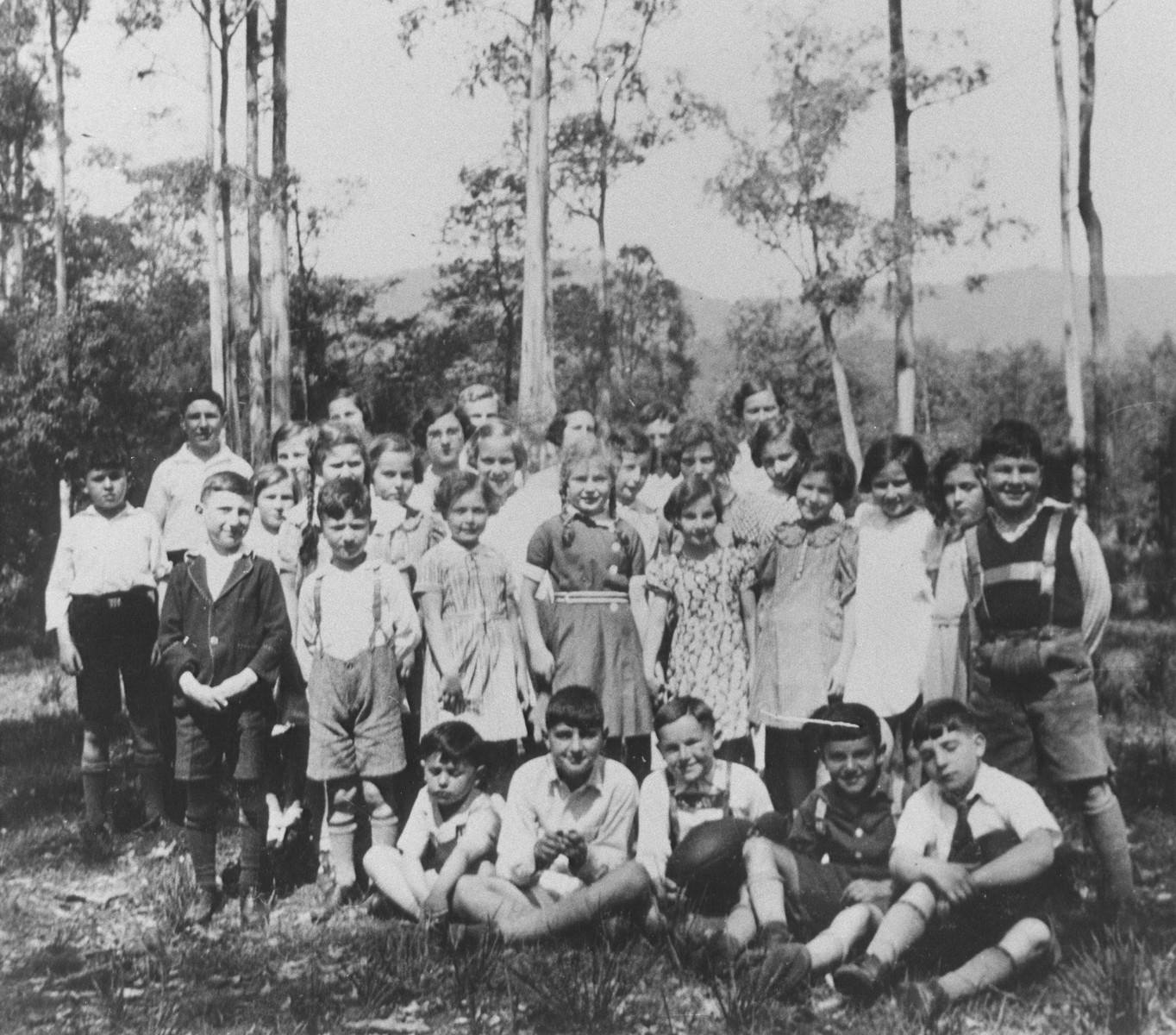 Seventeen Jewish refugee children join other children on a picnic shortly after their arrival in Melbourne.  Aged twelve or under, they were the only German-Jewish children to be sheltered in Australia during the war.