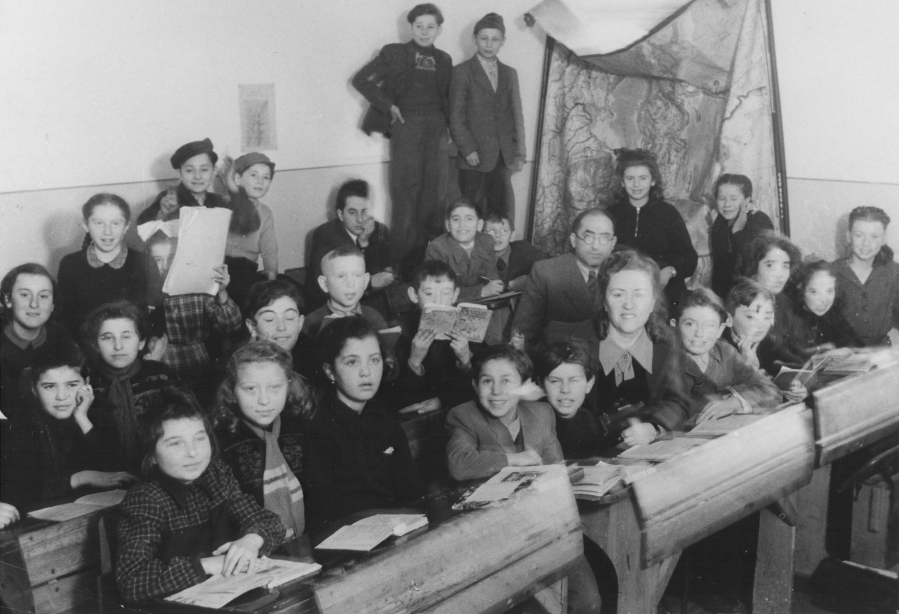 Children sit at their desks in a classroom in the Feldafing displaced persons camp.
