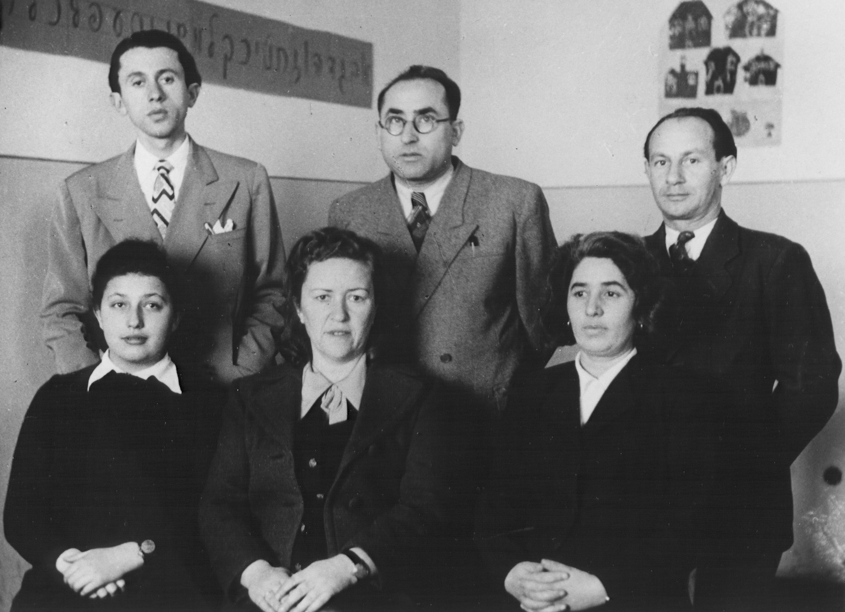 Teachers in the Feldafing DP camp.  Simon Schochet, who taught history and English, is standing on the left.  The Hebrew alphabet is pasted to the wall.