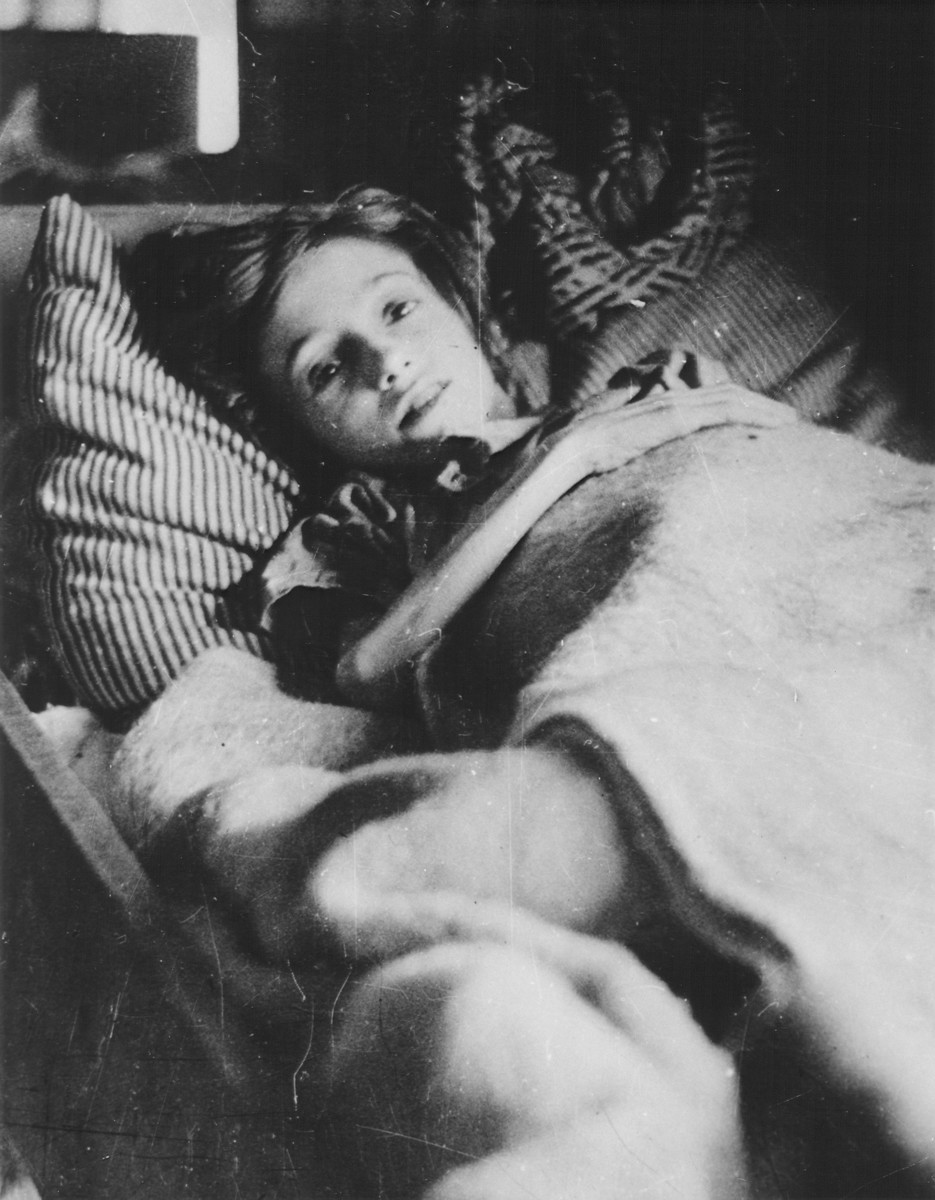 A twelve-year-old Jewish girl lies in bed after her liberation in Bergen-Belsen.  Pictured is Helena Rabbie.  She was born in Amsterdam on September 8, 1933, and died in Bergen-Belsen on April 24, 1945, eleven days after the liberation.