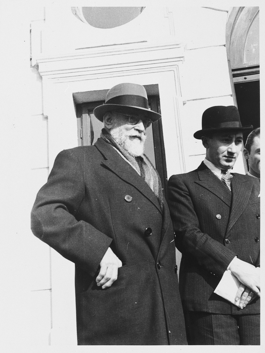 Constantin Brãtianu (1866-1950), leader of the National Liberal Party in Romania stands outside a building accompanied by an unidentified younger gentleman.