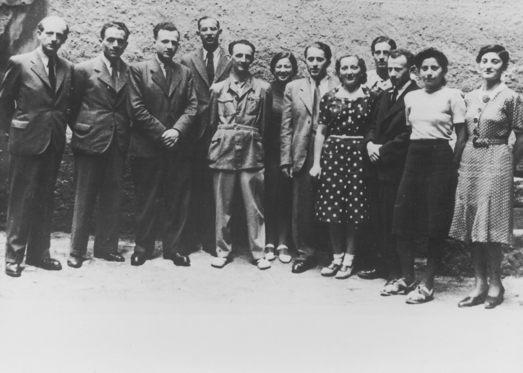 Group portrait of teachers at the Jewish school in Prague.  Pictured from left to right are Teitelbaum, unknown, Gruenberg, unknown, Pavel Weisz, the director Lauscherova, Dr. Reich, Kacerova, unknown, Sandner, Reinerova and unknown.