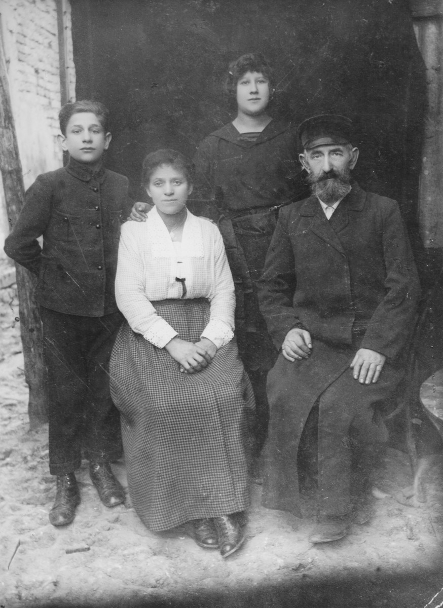 Portrait of the Faigen family in Luboml.  Those pictured include Basia Faigen, her parents and brother.
