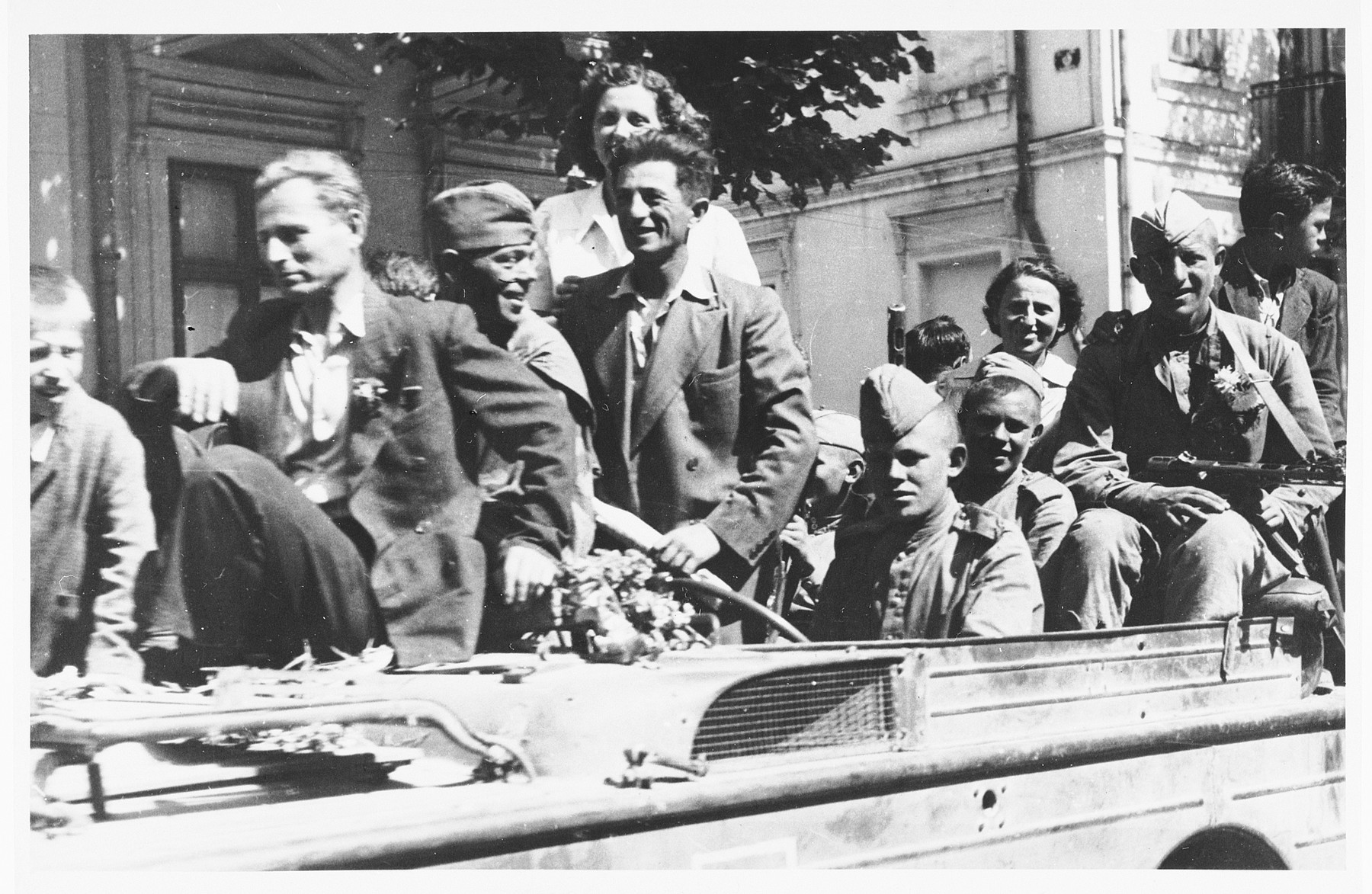 Romanian citizens surround and greet the first Soviet soldiers to enter Bucharest.