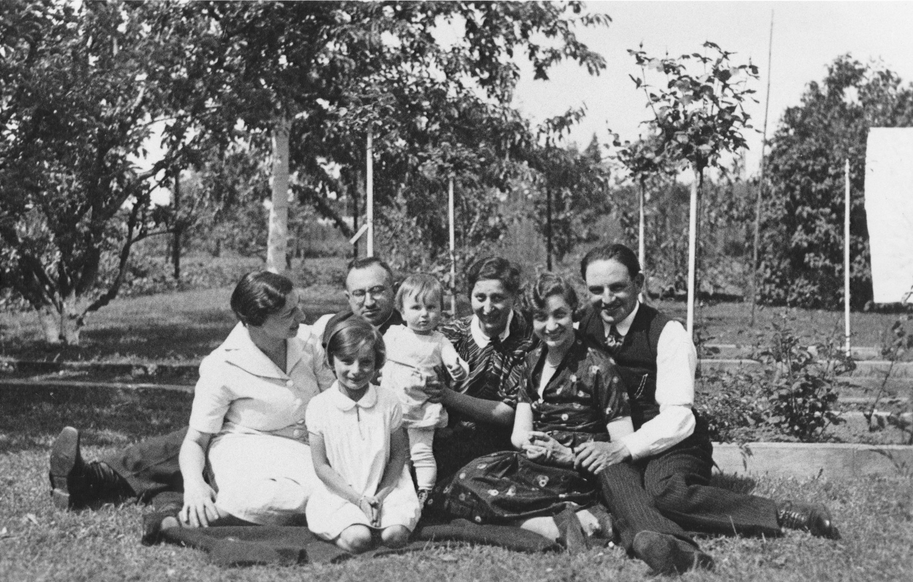 Group portrait of members of a Jewish family in the backyard of their home in Lechenich, Germany.  Pictured clockwise from the front left are: Inge, Sara, Joseph, Gisela, and Klara Berg as well as Erna and Adolph Baum.