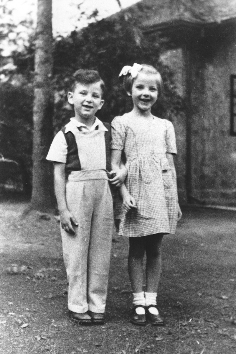Two young Jewish refugee children pose on their family farm near Limuru, Kenya (Kiambu district), where they found refuge during World War II.  Pictured are Philip Berg (left) and Hannah Mandlebaum (right).