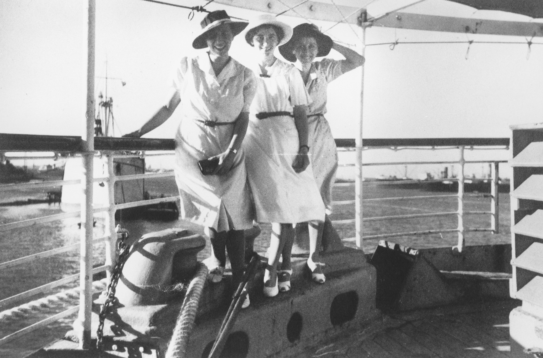 Three Jewish refugee women sail aboard the Usambara to Kenya.  Pictured are Sara, Else and Klara Berg.  Each wears a new hat.  They had each purchased new wardrobes to circumvent the restrictions allowing them to take only ten Reichsmarks out of the country.  Unfortunately, most of their new clothing was stolen at the pier by German dockworkers.