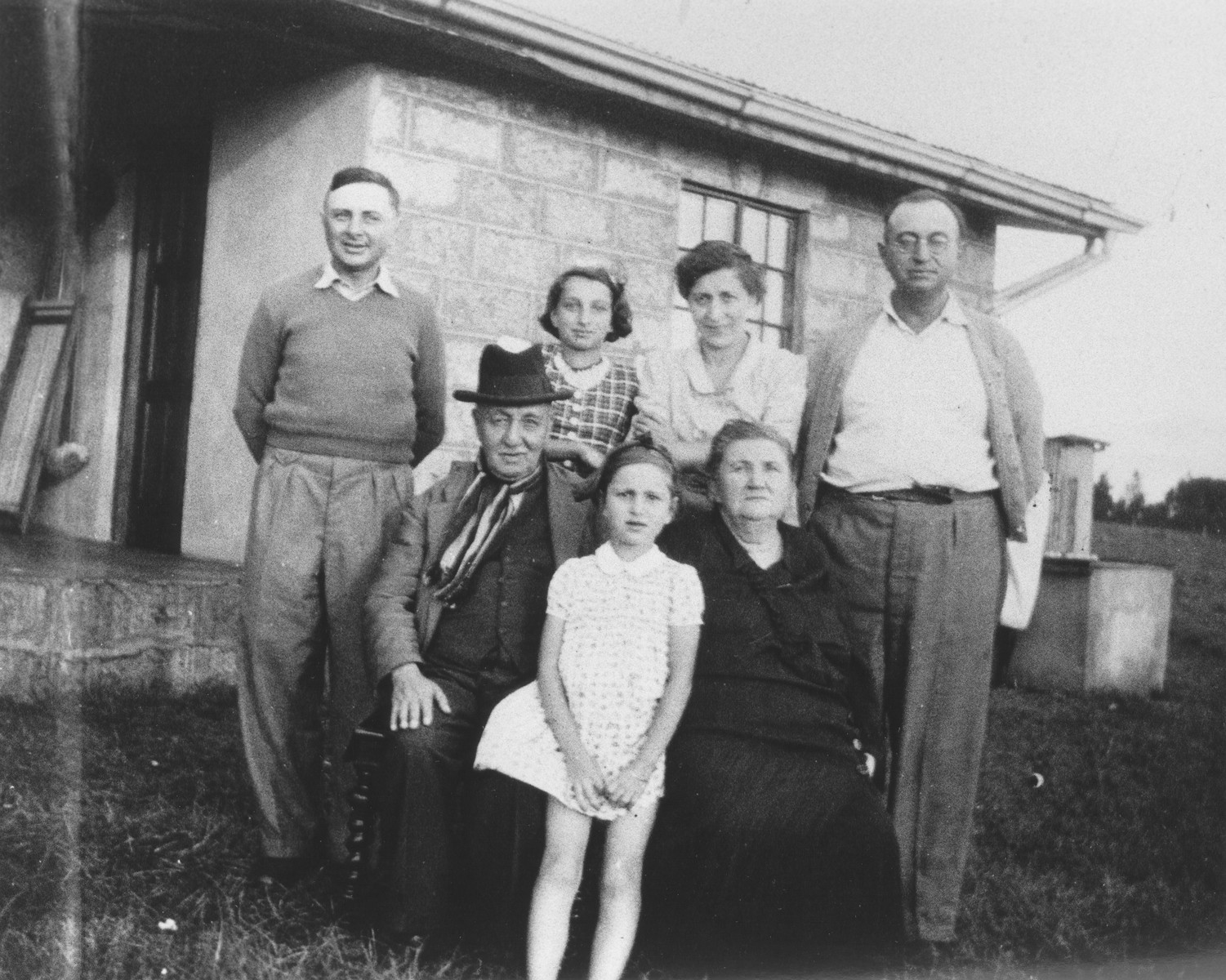 Group portrait of members of the extended Berg family on their farm near Limuru, Kenya (Kiambu district), where they found refuge during World War II.  Pictured are Joseph and Klara Berg, their daughters Inge and Gisela and parents Max and Klara.  Also pictured is Joseph's cousin also named Josef Berg.
