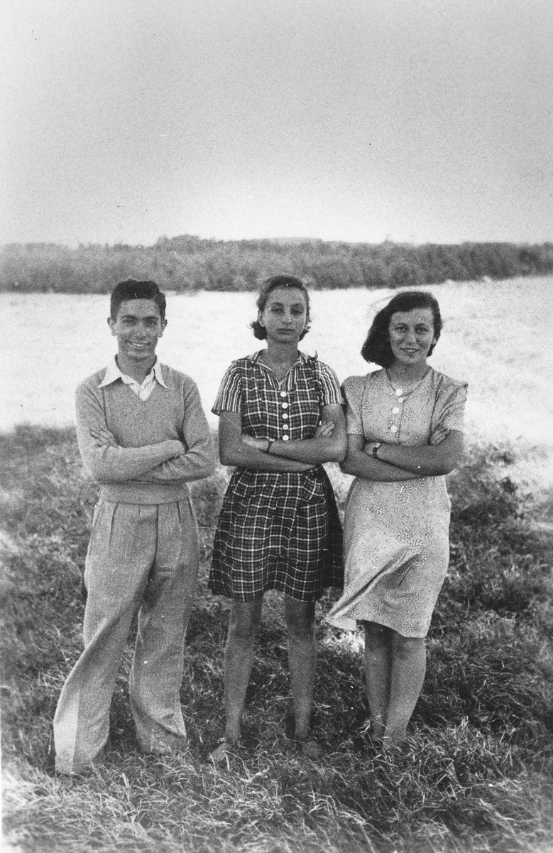 Three Jewish refugee teenagers pose outside in Kenya.  Pictured from left to right are: Jack Banin, Inge Berg and Rita Freed.