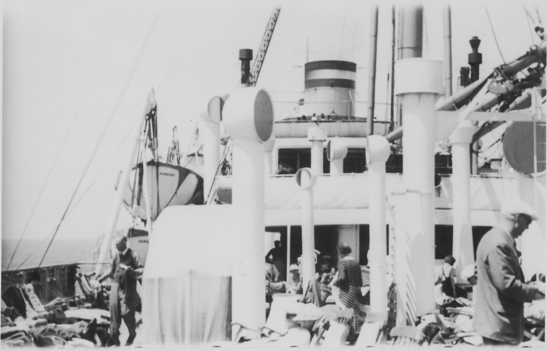Passengers gather on a deck of the MS St. Louis.
