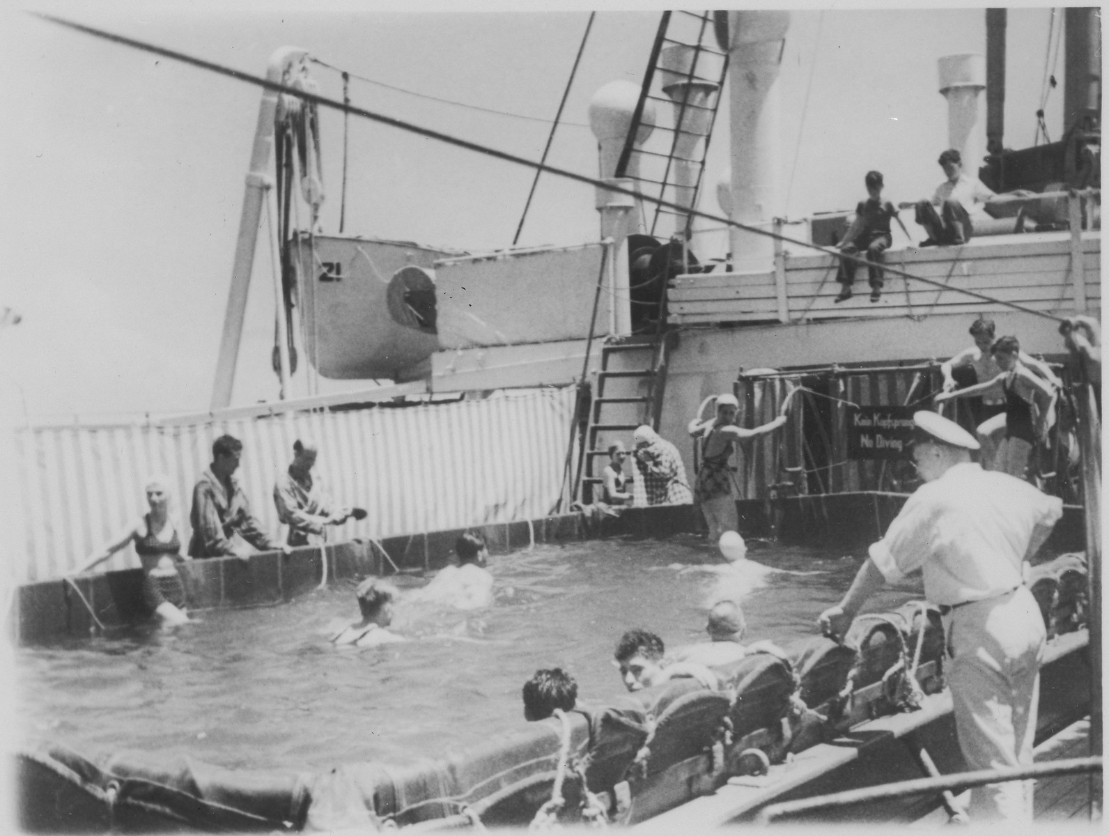 Jewish refugee passengers aboard the MS St. Louis bathe in the swimming pool on the deck of the ship.