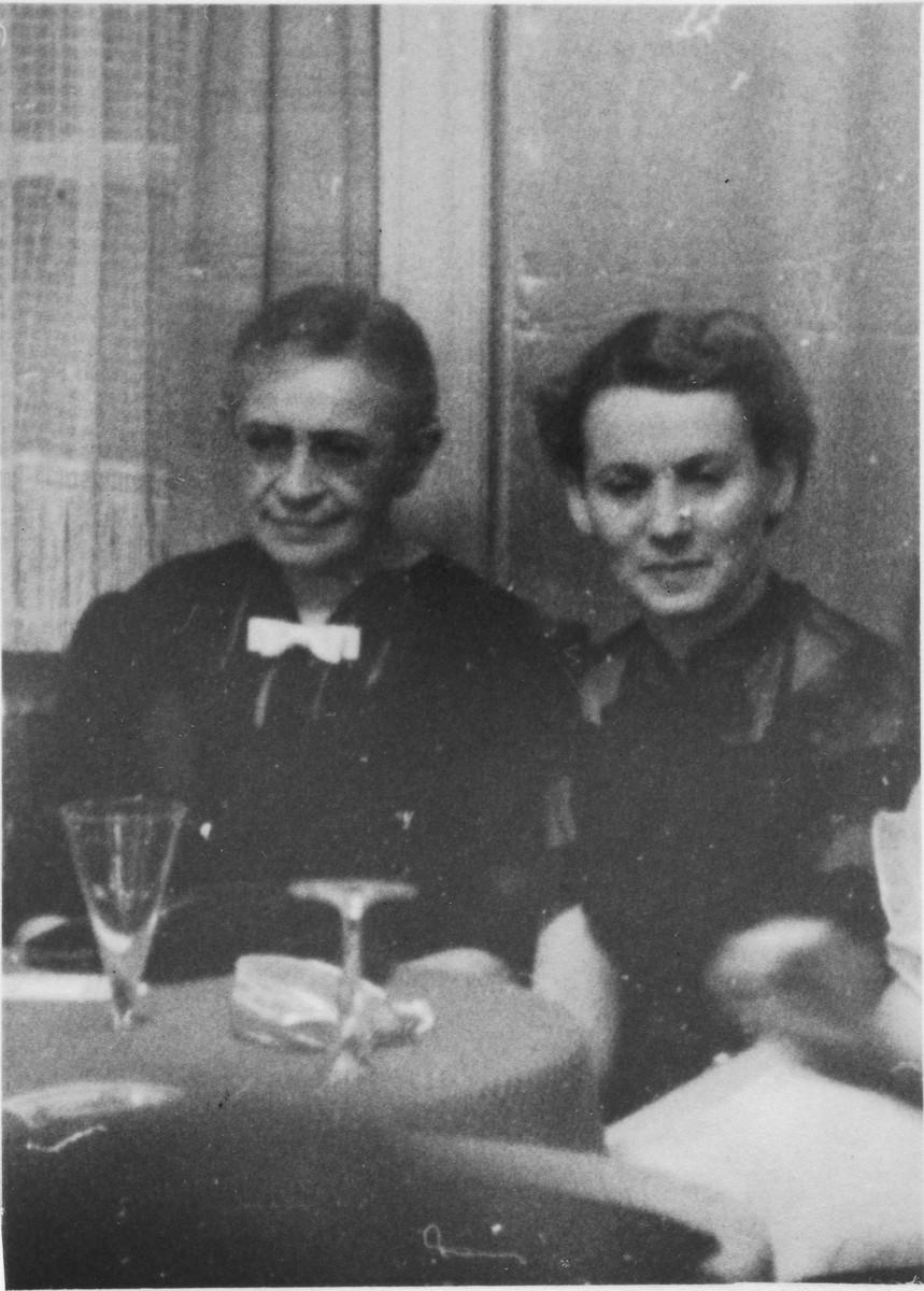 Two women drink champagne aboard the MS St. Louis.