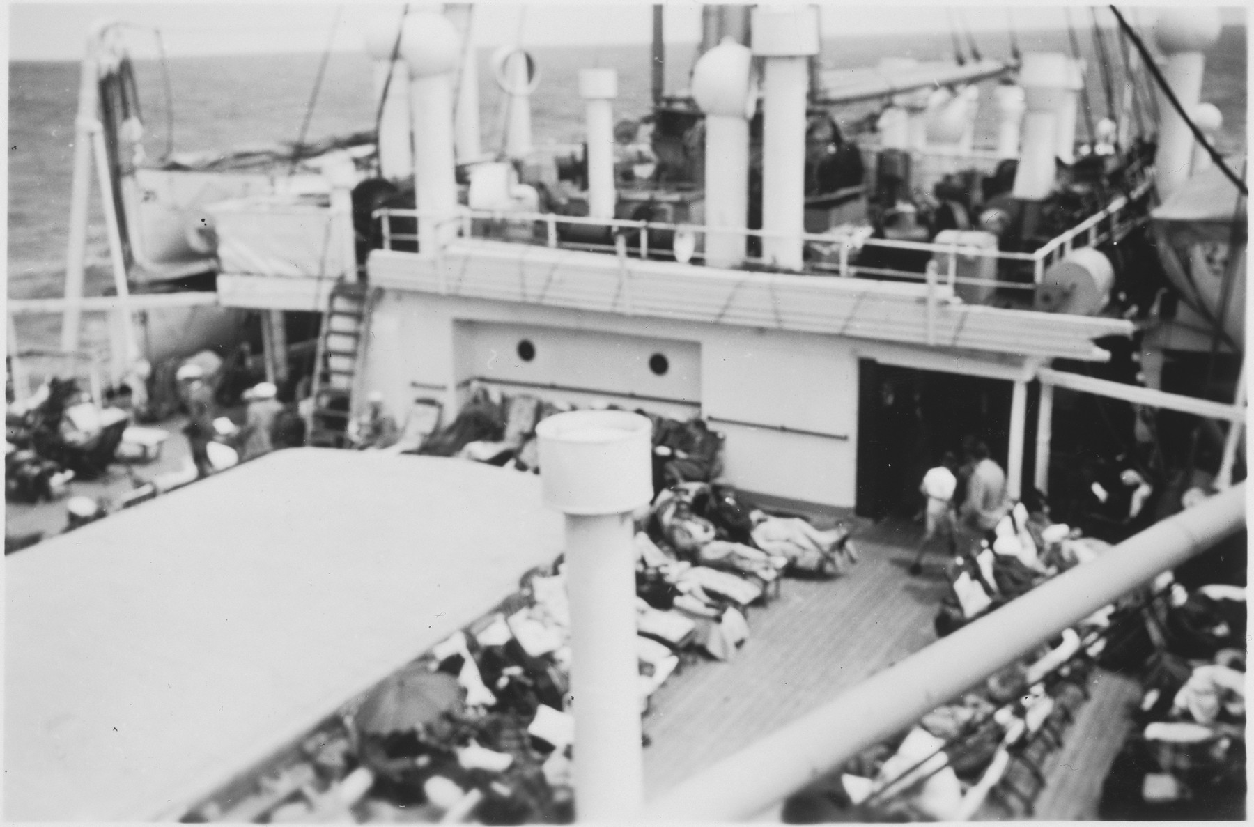 View of Jewish refugee passengers lounging on the deck of the MS St. Louis.