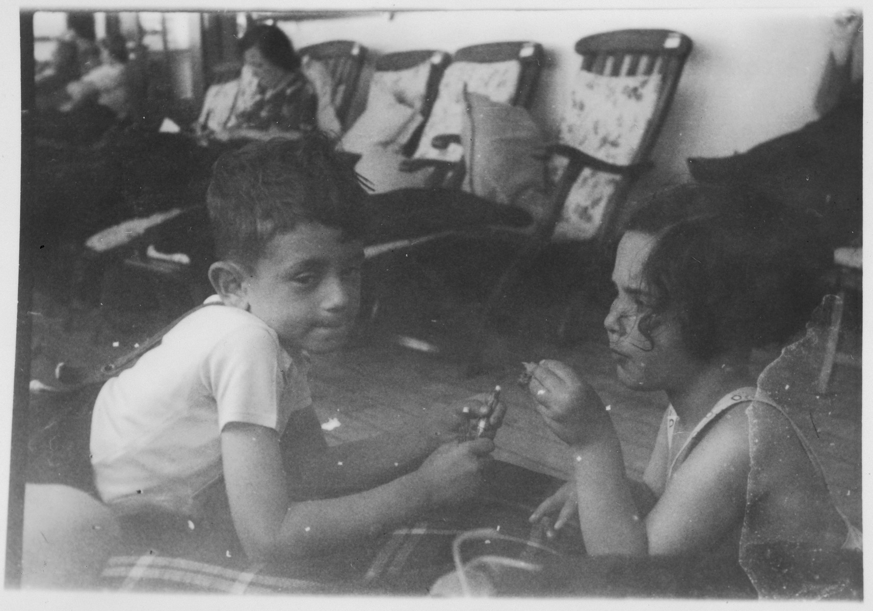 Two young Jewish refugee children play together on the deck of the MS St. Louis.