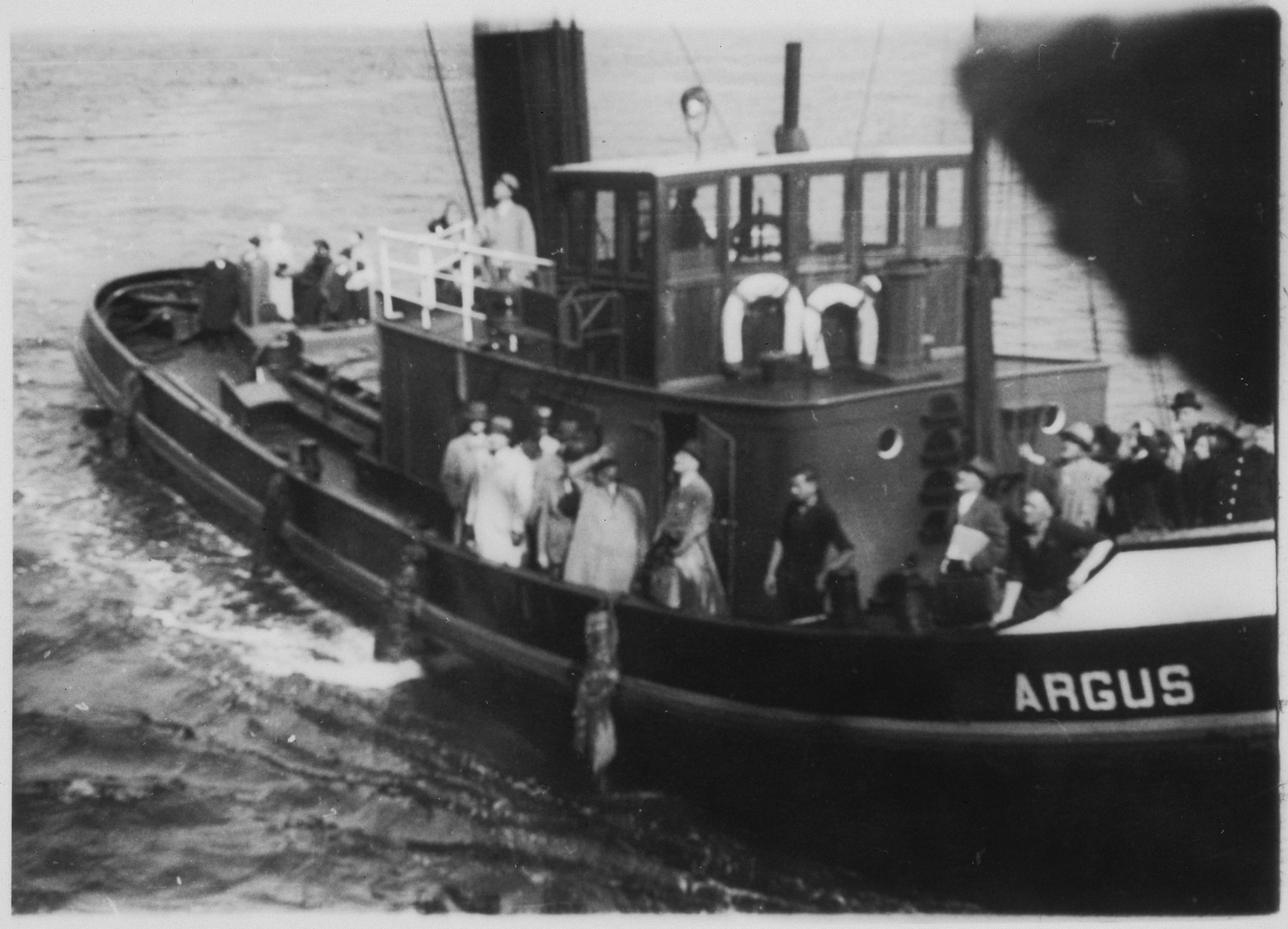 Relatives of passengers aboard the MS St. Louis approach the refugee ship in a tugboat called the Argus.