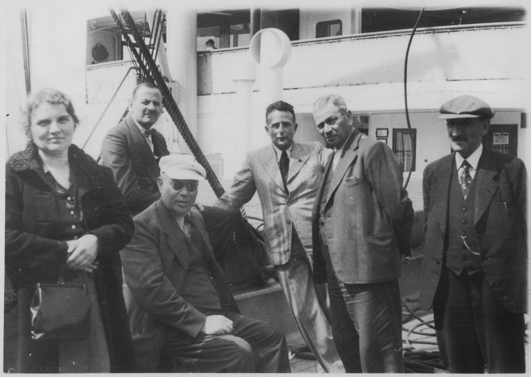 A group of pasengers gathers on the deck of the St. Louis.