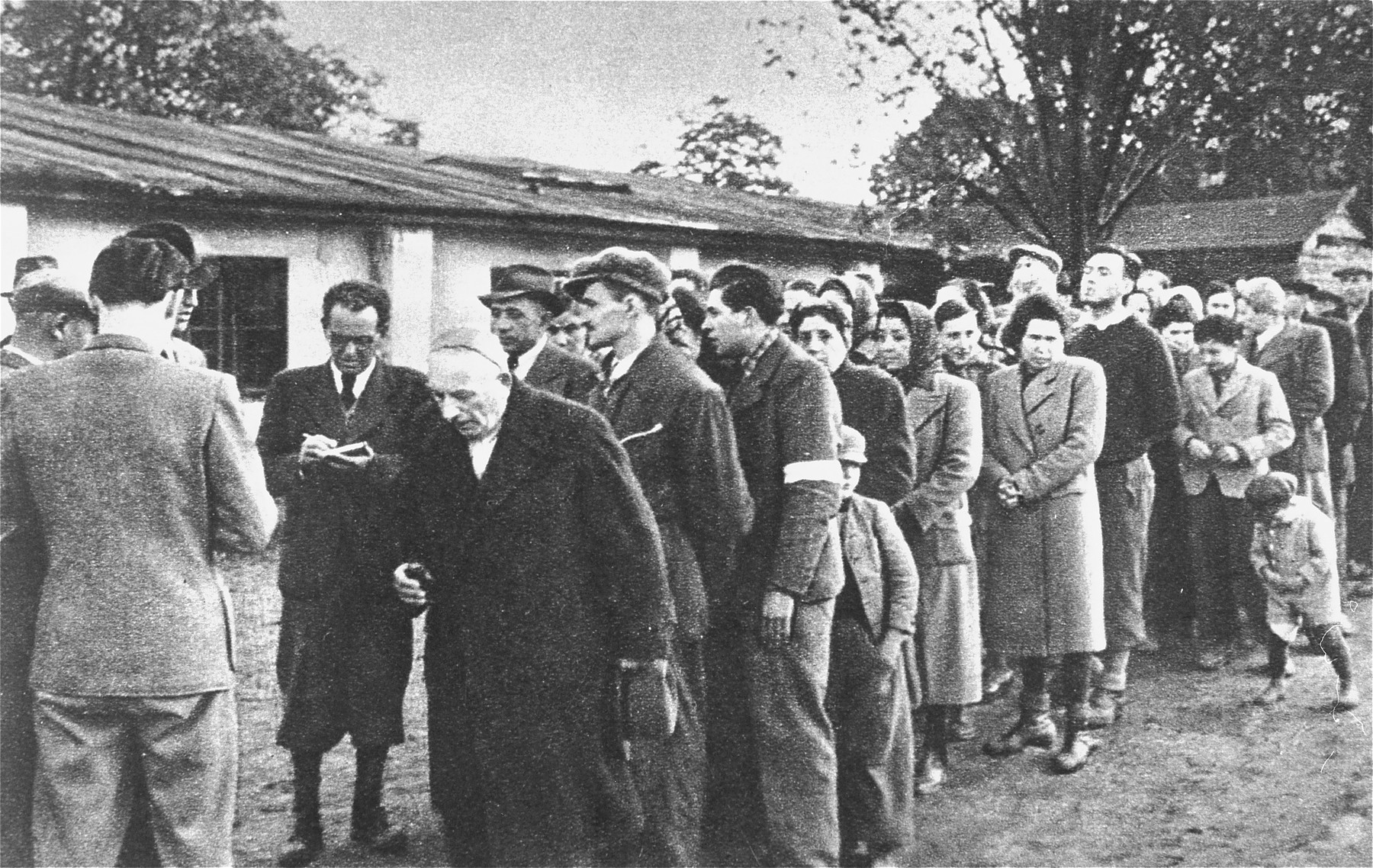 Slovak officials check off the names of Jews who are about to be deported at an assembly point in Zilina, Slovakia.