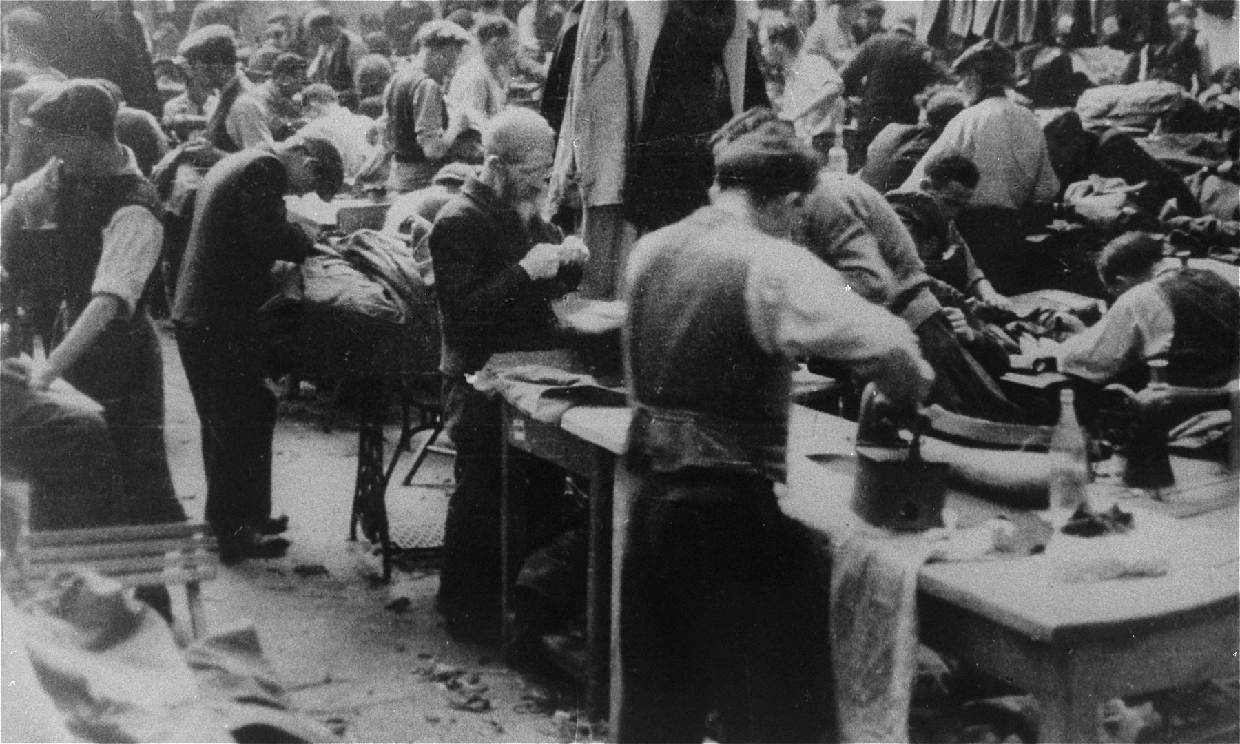 Jewish men work in a clothing workshop in the Lodz ghetto.
