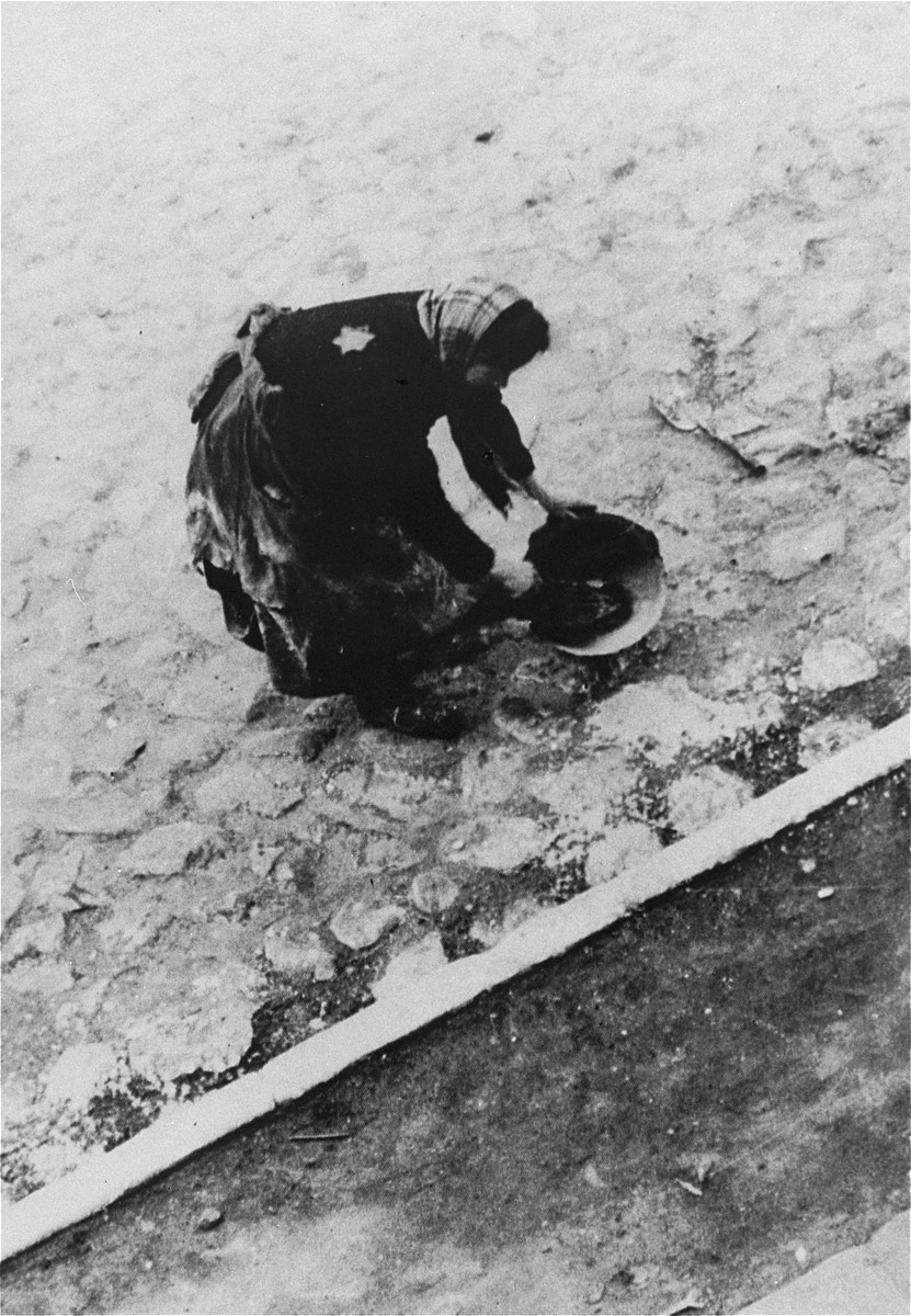 A woman street cleaner in the Lodz ghetto.