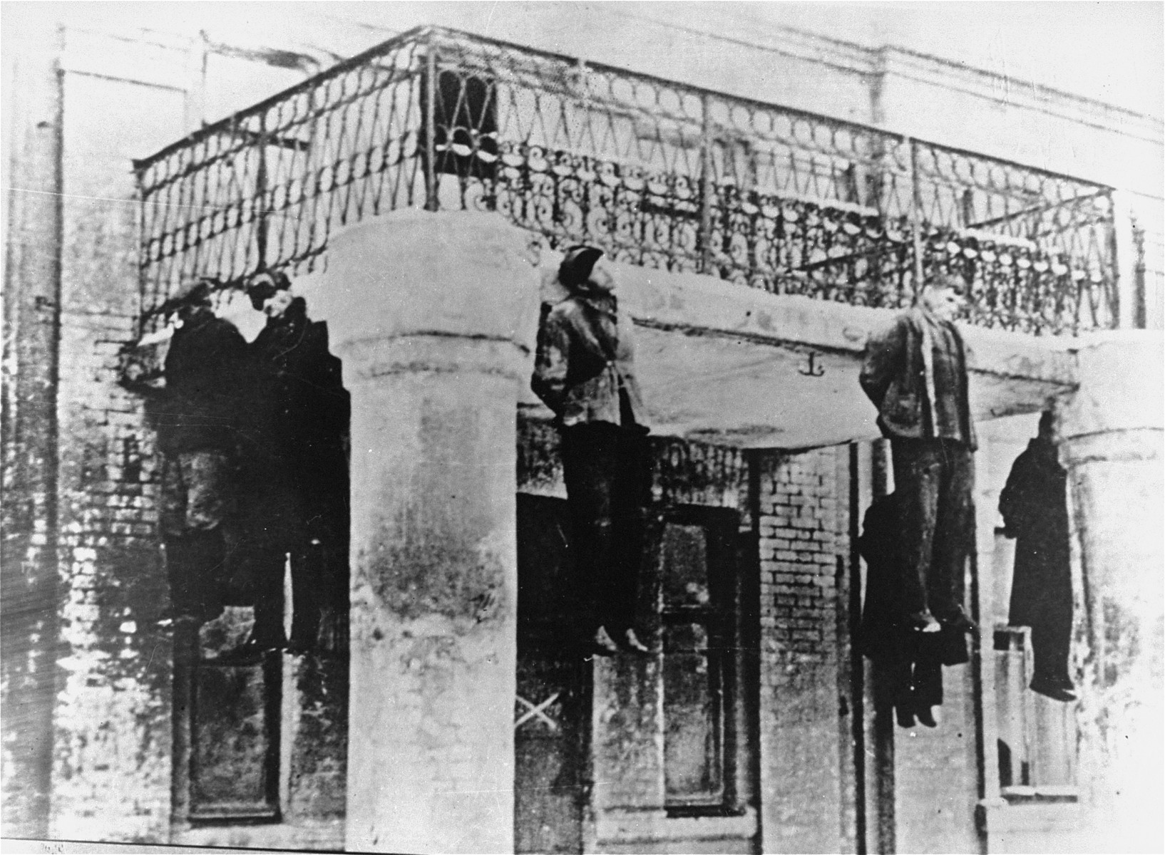 Execution by hanging from a balcony on Zolkovkoy Street in Lvov.   The photo was found in the Lvov Gestapo after the liberation of the city in July 1944.