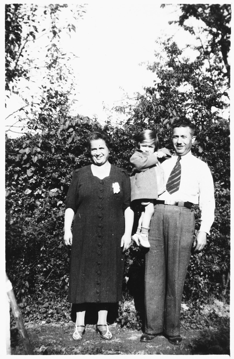 Tema and Max Rotenberg hold their youngest child, Sonja, while in hiding.