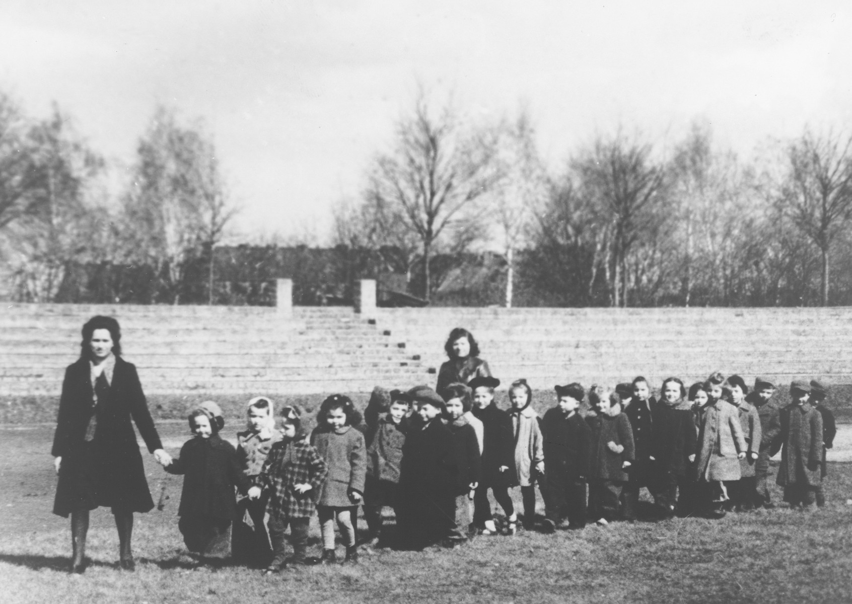 Preschoolers in the Mariendorf displaced persons camp go for a walk.  Those pictured include Maya Rosenfeld (later Freed Brown).