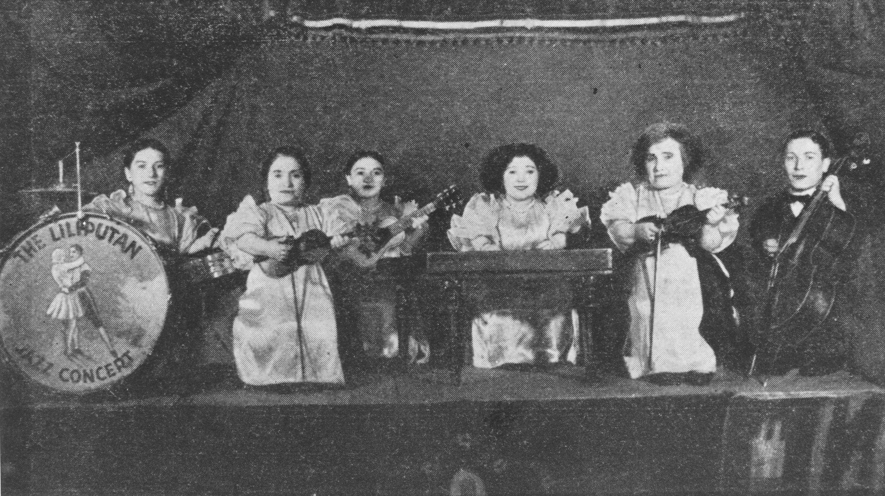 Group portrait of the Ovici family, a family of Jewish dwarf entertainers who survived Auschwitz, in a performance of the Liliputan Jazz Concert.