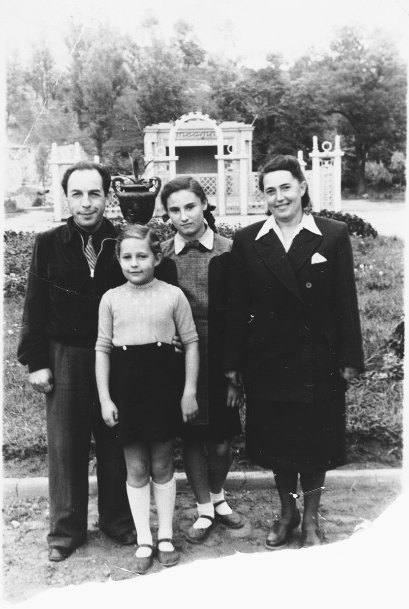 The Pomerants family poses in a park in Vilnius after the war.  From left to right are Daniel Pomerants, Danute, her adopted sister Ruta,  and her mother Lusya.