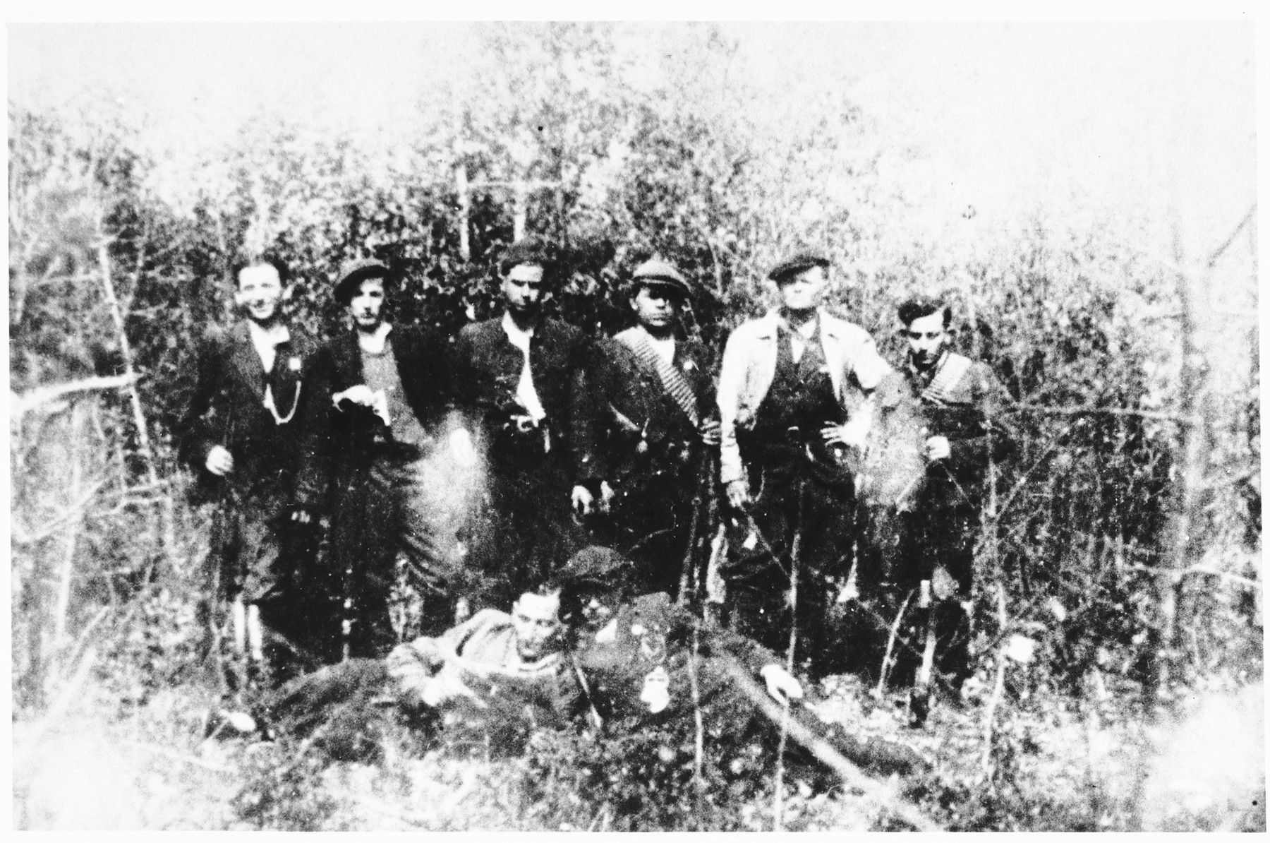 Group portrait of Jewish partisans in the forest.