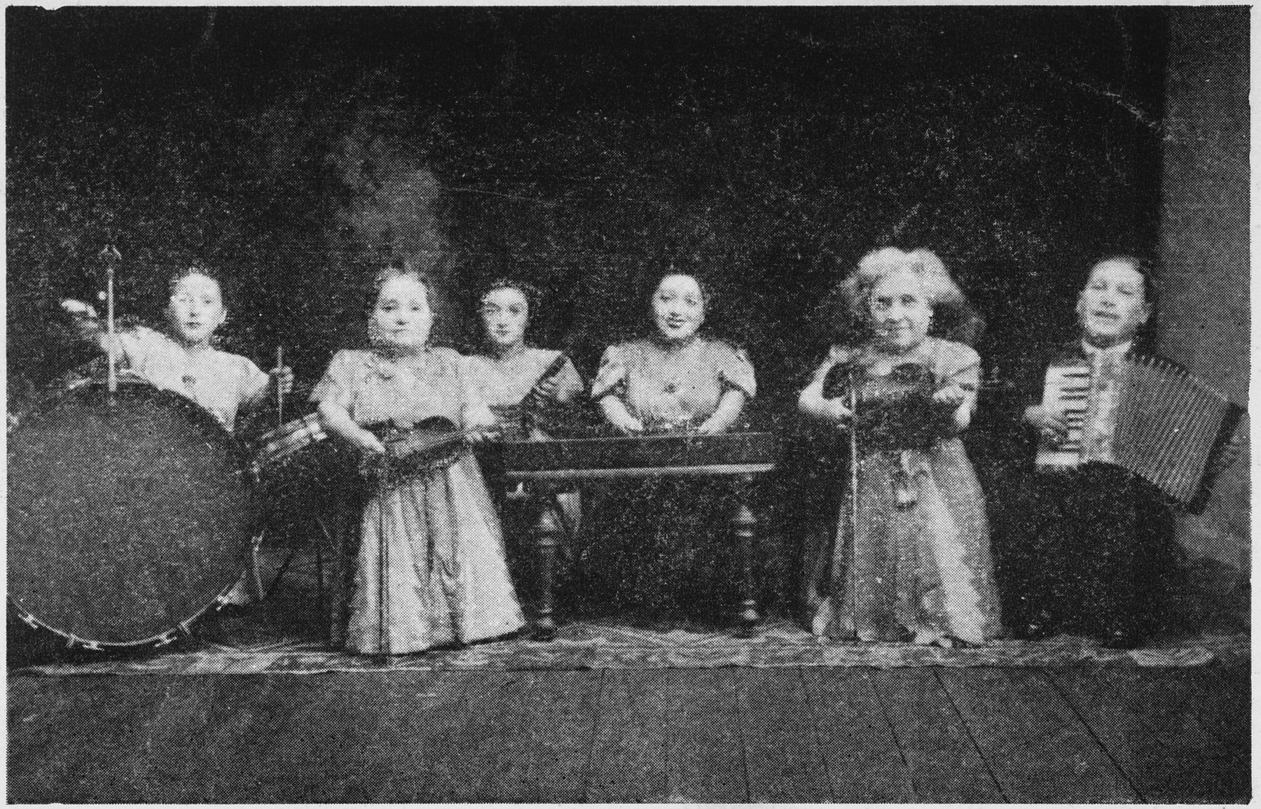 A press photo of the Ovici family of dwarf musicians, which they brought with them to Auschwitz and gave to a guard upon their arrival.  From left to right are Elizabeth, Rozika, Perla, Frieda, Francesca and Micki Ovici.