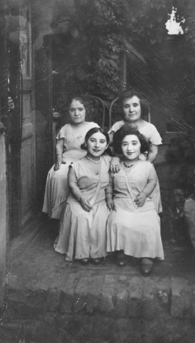 Group portrait of four female members of the Ovici family, a family of Jewish dwarf entertainers known as the Lilliput Troupe, who survived Auschwitz.  Bottom from left to right are Elizabeth and Frieda.  Top row are Rozika and Franceska.