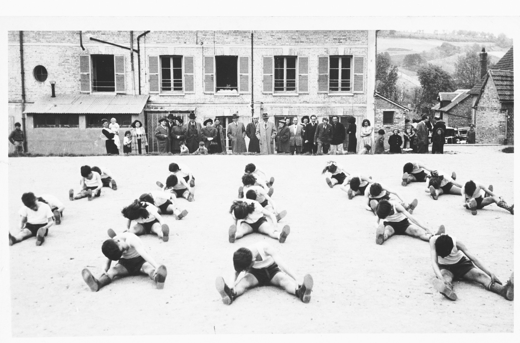 Children exercise in the courtyard outside the Nahum Aronson children's home in Les Andelys, France.